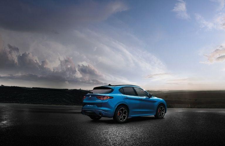 The 2022 Alfa Romeo Stelvio parked underneath the vast blue sky